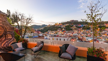 With a drink in hand, take in the beautiful views from the top of Casa del Rector Hotel Boutique