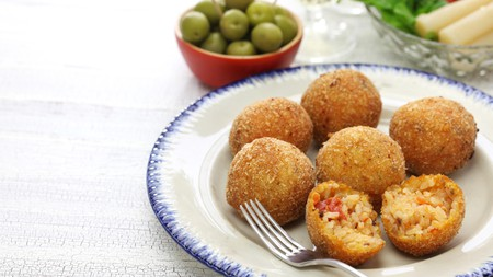 First cooked up in the 10th century, arancini are now a staple of Sicilian street food
