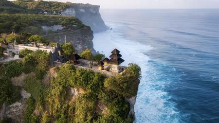 Pura Uluwatu temple sits at the edge of Bali, an island of adventure
