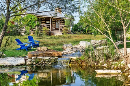 Stay in an alpine-inspired log cabin on a vineyard at Barons CreekSide