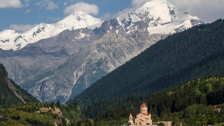 A church in Mestia, Georgia, with the Caucasus Mountains in the background