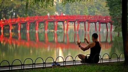 The pretty scarlet bridge at Hoan Kiem Lake makes for a beautiful backdrop for a photo