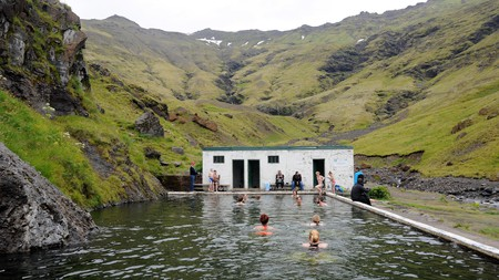 Seljavallalaug is a geothermally heated outdoor swimming pool built into the mountainside