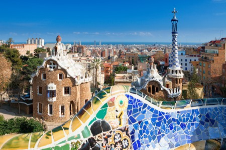 Book into an affordable hostel and save more of your budget for exploring Barcelona, seen here from Park Güell