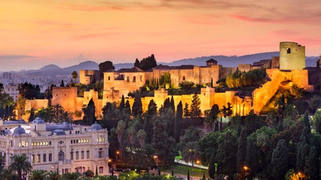 At sunset, the Alcazaba in Málaga, Spain, is tinged in a warm orange
