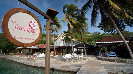 The Frangipani Hotel, in Bequia, is home to a popular seaside bar