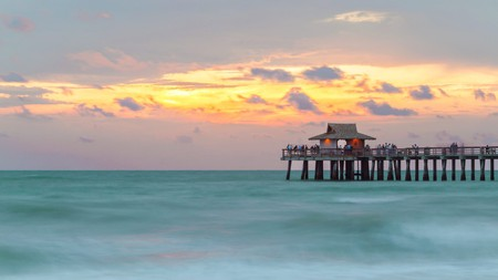 Naples Pier in the Gulf of Mexico is an exceptional place to watch the sunset in Florida