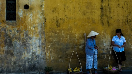 Fruit sellers take to the shade on a hot day in Hội An, Vietnam