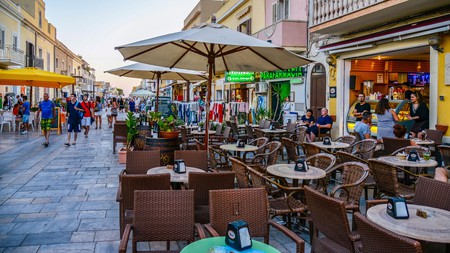 The bustling Via Roma on the island of Lampedusa is home to bars, restaurants and shops