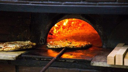 Pizza coming out of the wood-fired oven at the famous L'Antica Pizzeria Da Michele in Naples