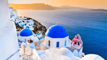 Sit back with a drink in hand, and soak in the views of Oia