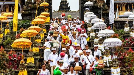 Balinese locals attend a Batara Turun Kabeh ceremony