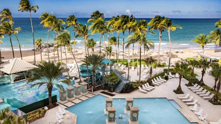 Grab a lounger at the San Juan Marriott Resort for a chilled afternoon dipping in the pool or ocean