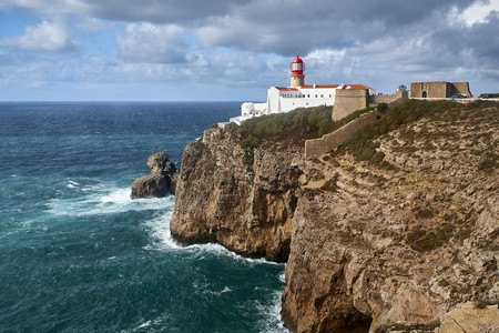 The Cabo de Sao Vicente Lighthouse stands on the Algarve coast where many stunning resorts await