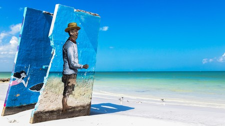 Discover fascinating street art on the beach during a trip to Isla Holbox