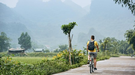 Going on a bike ride through Vietnam's natural landscapes is one of the many ways you can practice ecotourism on your next visit here