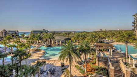 Pools lined with palm trees beckon at the Henderson Lofts in Destin, Florida