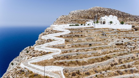 The Church of Panagia rises above the Aegean on the island of Folegandros, where the hotels are as charming as the island itself