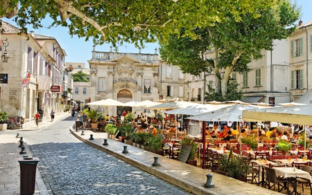 Relax under the shady trees in Place Crillon, in the heart of historic Avignon