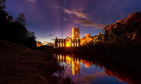 Fountains Abbey reflected in the waters of the surrounding gardens