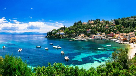 At Loggos in the north of Paxos, fishing boats bob in the serene waters and a handful of tavernas and cafes cluster at the shores
