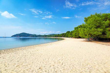Koukounaries Beach on Skiathos, Greece, beckons with golden sands