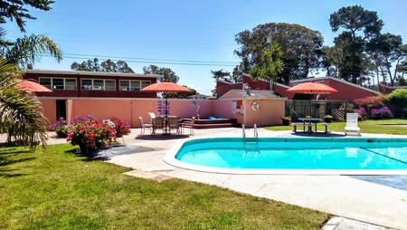 Enjoy a swim in Butterfly Grove Inn's outdoor pool before heading over the Monterey Bay Aquarium