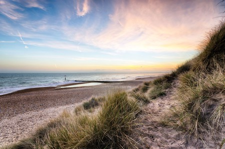 Enjoy a stunning sunset along the sand dunes at Hengistbury Head near Bournemouth