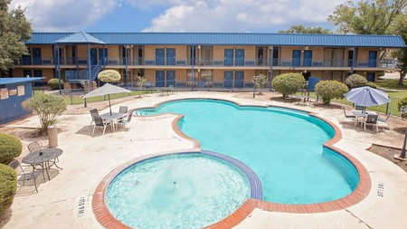Relax poolside at the Days Inn by Wyndham Bay City