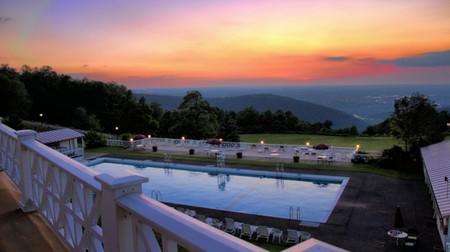 Enjoy sunset views from the pool at the Historic Summit Inn in Farmington