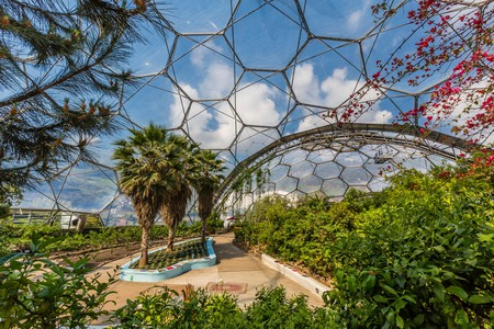 Explore the fascinating greenhouse domes at the Eden Project before a cosy stay nearby