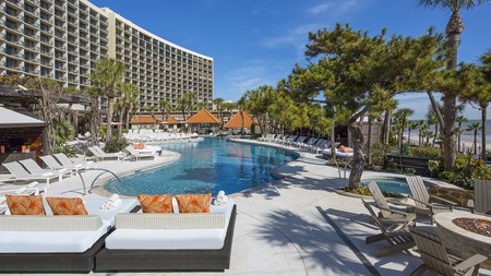 The San Luis Resort, Spa & Conference Center offers the best of both worlds with a lush pool area and easy beach access