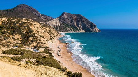 Rugged cliffs line Cavo Paradiso Beach on Kos, Greece