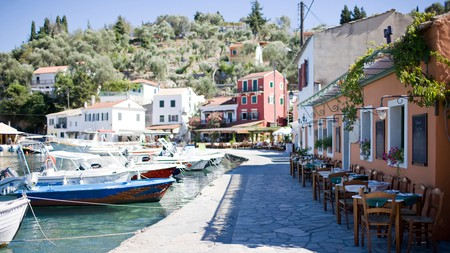 Look out over bobbing boats while you dine on Paxos, Greece