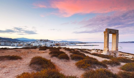 Catch the spectacular sunset views from the Temple of Apollo over the old town on Naxos island