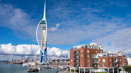 The Spinnaker Tower pierces the clouds over Gunwharf Quays in Portsmouth