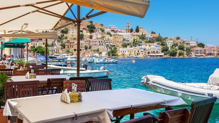 Have your meals with harbour views in Symi town
