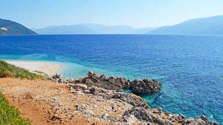The multihued waters of Aspros Gialos Beach, free of boats and water sports, are ideal for swimmers