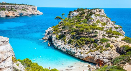 Visit the Balearic island of Mallorca, for buzzing nightlife and endless beach vibes