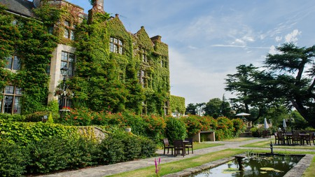 The façade of the Pennyhill Park Hotel and Spa in Bagshot is covered in ivy