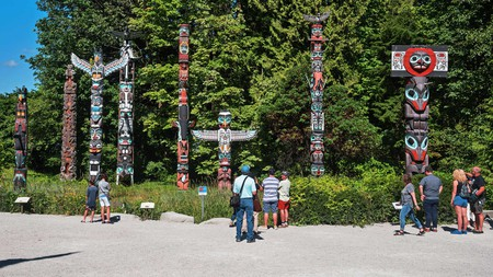 The nine First Nations totem poles in Stanley Park are an extraordinary example of Indigenous art