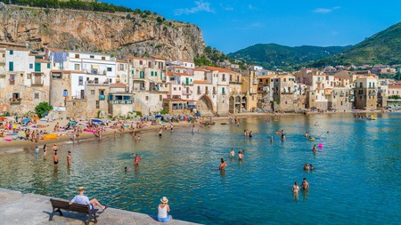 Find a sandy patch of shoreline in Cefalù and relax
