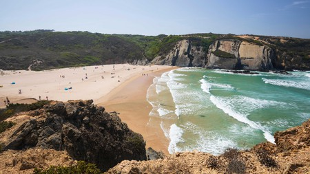 Escape the tourist-filled beaches and head to the tranquil Praia do Carvalha