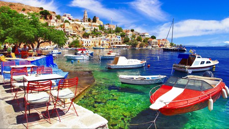 Enjoy a cocktail with stunning views of the harbour when you visit Symi