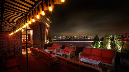 Enjoy views of the Hudson and the Manhattan skyline from the rooftop bar of the Jane Hotel