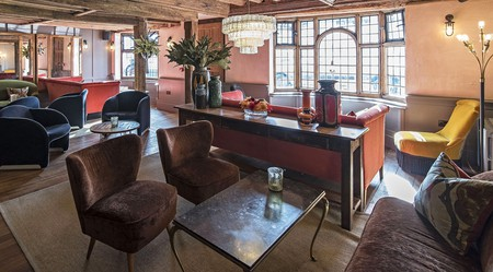 The Falstaff Inn offers an intimate lounge where modern furniture melds seamlessly with heritage detail