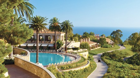 Relax poolside at the Resort at Pelican Hill in California