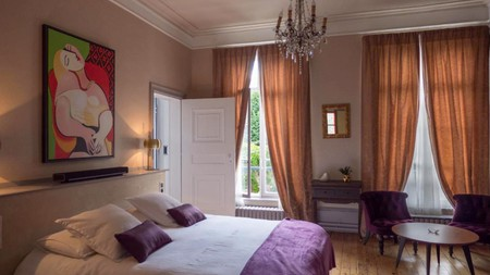 Homely rooms at Une maison en Ville Amiens offer a peaceful place to unwind