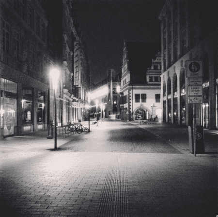 Downtown Leipzig at 4 am. Here you can see a part of Grimmaische Straße. It seems like silence and light are on a first date and I'm there to take the first photograph.