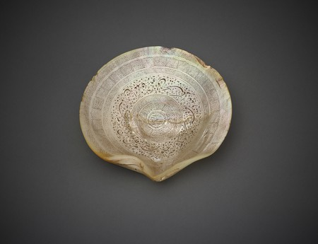 Shell With Inscriptions: India, 18th century, Incised mother-of-pearl   © Aga Khan Museum